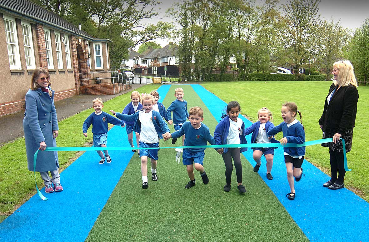 Daily mile track for pupils at Holyoakes opened by Rachel