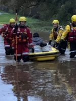 Rescued: The driver is brought to safety. Picture by Roy Edwards.